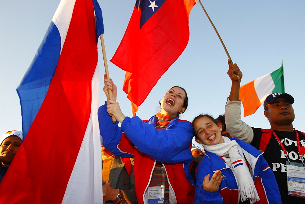 Young Catholics wave flags during World Youth Day, Sydney, New South Wales, Australia, Pacific