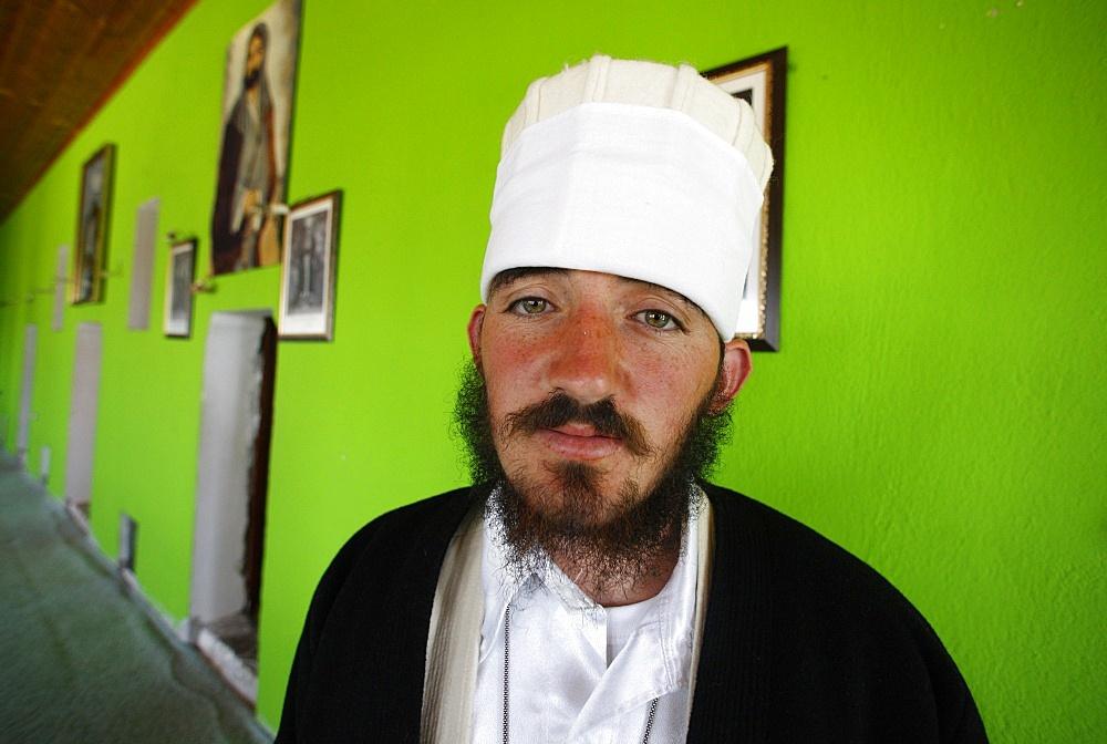 A 22-year old dervish, Myrteza Shehu, in Melani tekke, Vranishti, Girokastre, Albania, Europe