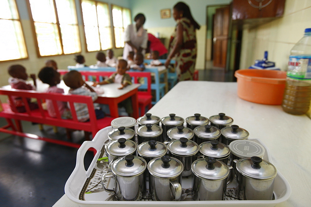 Meal time at a nursery and kindergarten run by Catholic nuns, Lome, Togo, West Africa, Africa