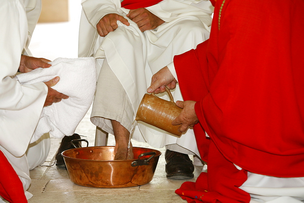 Bishop washing the feet of newly ordained deacons, Pontigny, Yonne, France, Europe