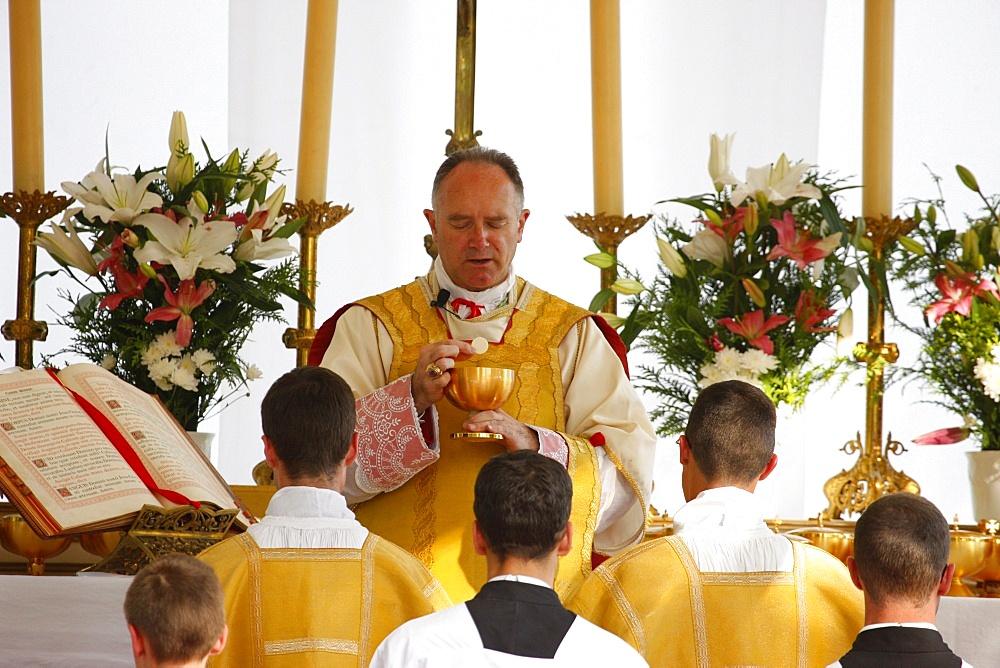 Mgr Bernard Fellay, head of Saint Pie X Fraternity, celebrating Mass during a traditional Catholic pilgrimage, Villepreux, Yvelines, France, Europe - 809-3031