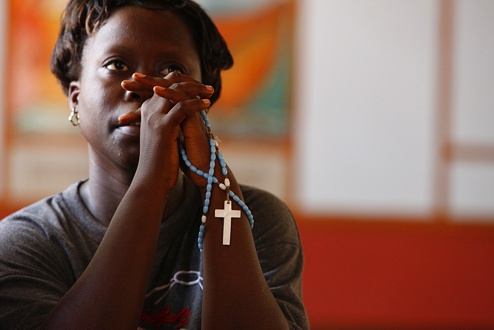 Christian woman praying, Togoville, Togo, West Africa, Africa