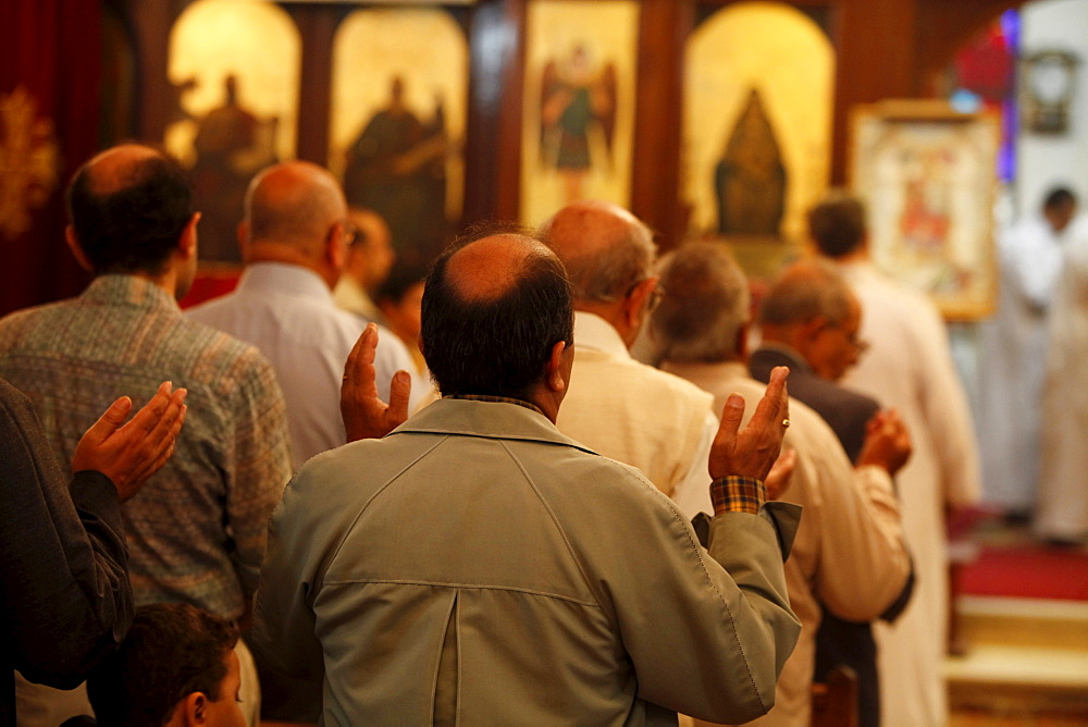Men's section during celebration in Abbassiya Coptic church, Cairo, Egypt, North Africa, Africa
