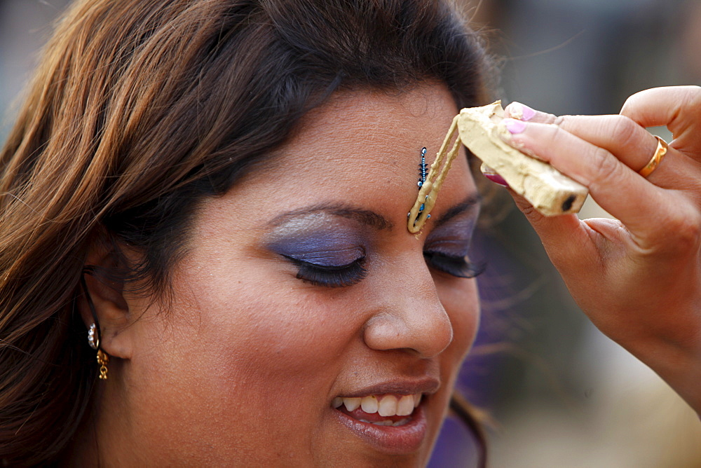 Tilak greeting at Janmashtami festival at Bhaktivedanta Manor ISKCON (Hare Krishna) temple, Watford, Hertfordshire, England, United Kingdom, Europe