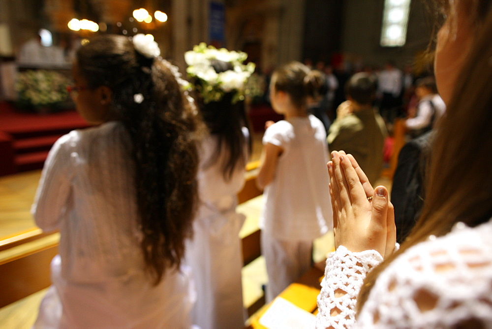 First Communion celebration in a Catholic church, Paris, France, Europe