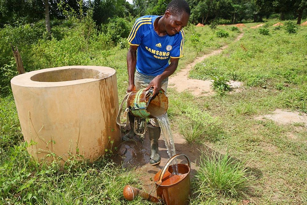 Man fetching water from well, Tori, Benin, West Africa, Africa