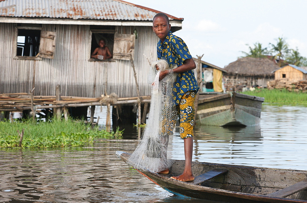 Fishing in Ganvie lake village on Nokoue Lake, Benin, West Africa, Africa