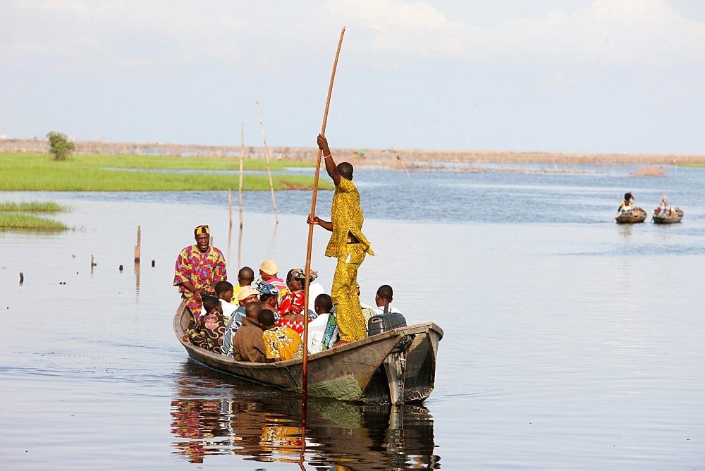 Boat with passengers, near Ganvie lake village on Nokoue Lake, Benin, West Africa, Africa