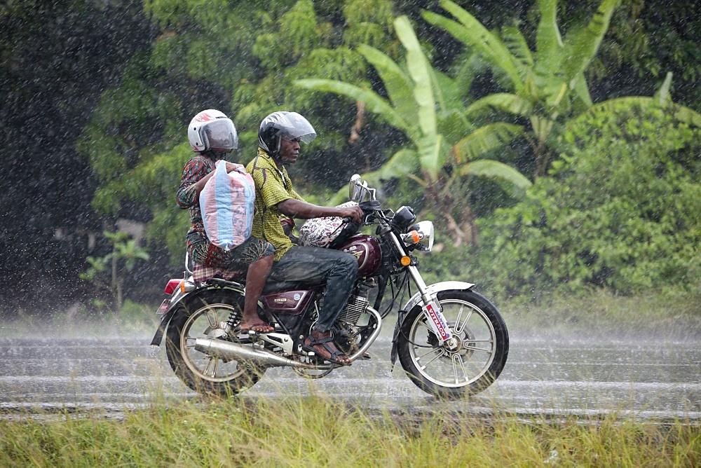 African road in the rain, Ouidah, Benin, West Africa, Africa