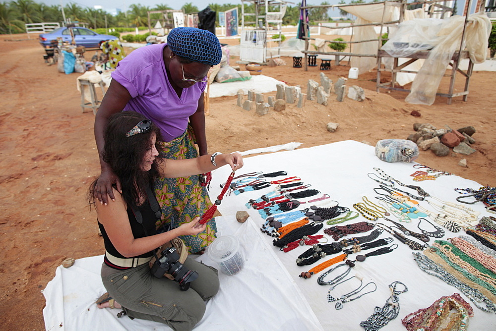 Woman buying souvenirs, Ouidah, Benin, West Africa, Africa