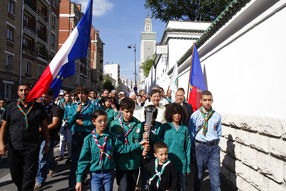 Muslim scouts carrying a torch outside the Paris Great Mosque, Paris, France, Europe