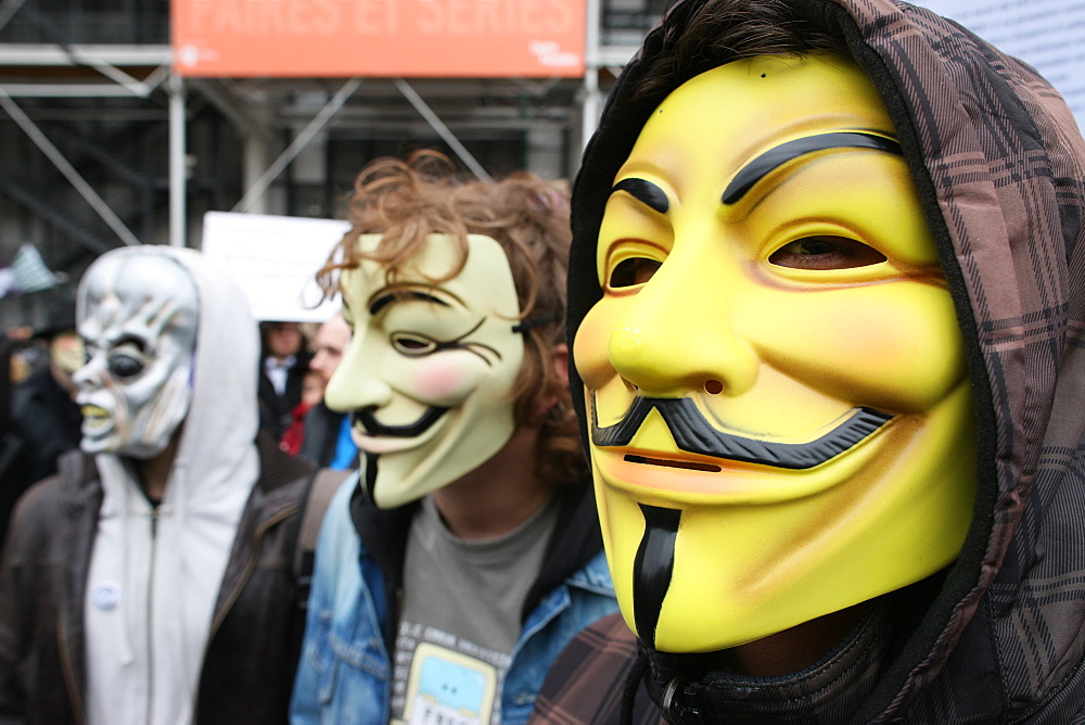 Protestors wearing Guy Fawkes masks, trademark of the Anonymous movement and based on a character in the film V for Vendetta, Paris, France, Europe