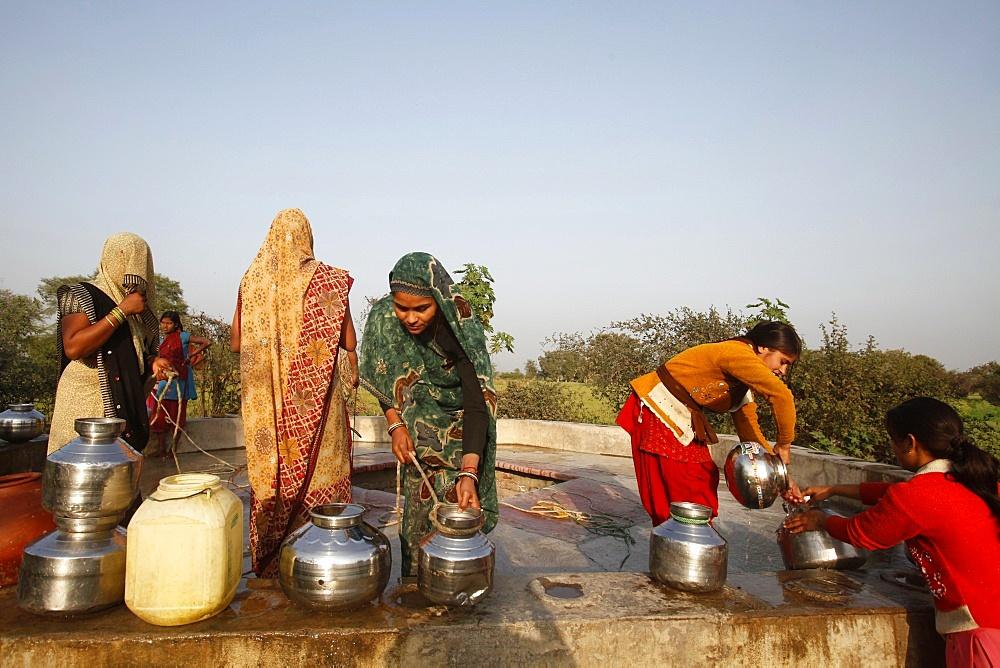 Women at a village well, Mathura, Uttar Pradesh, India, Asia