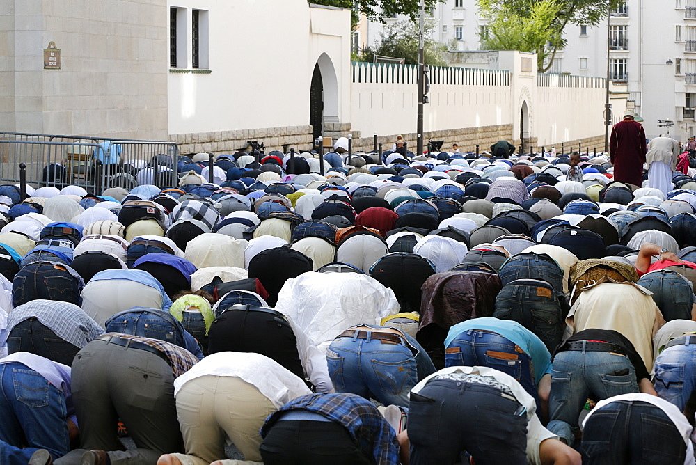Muslims praying outside the Paris Great Mosque on Eid al-Fitr festival, Paris, France, Europe