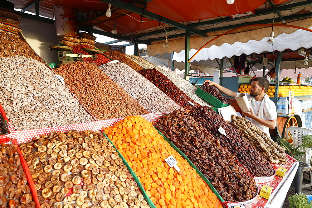 Dried nuts and fruits on a stand in a souk in Marrakech, Morocco, North Africa, Africa