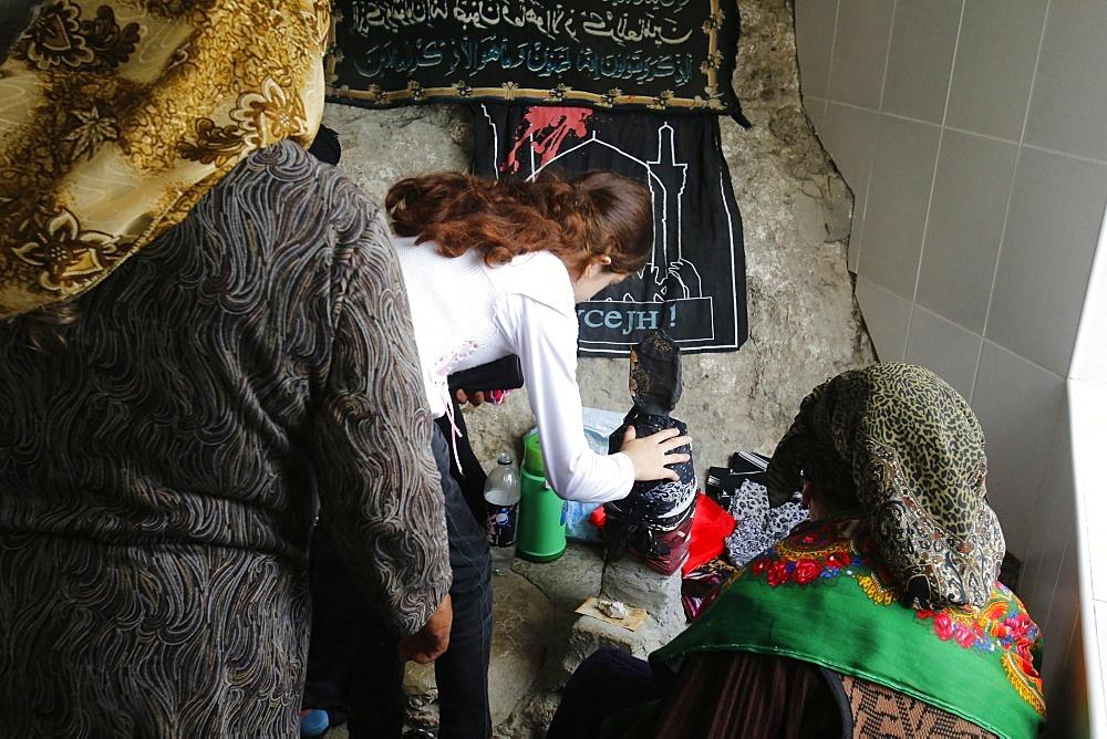 Pilgrims touching a stone in the shrine on Besh Barmaq mountain, Siyazan, Azerbaijan, Central Asia, Asia