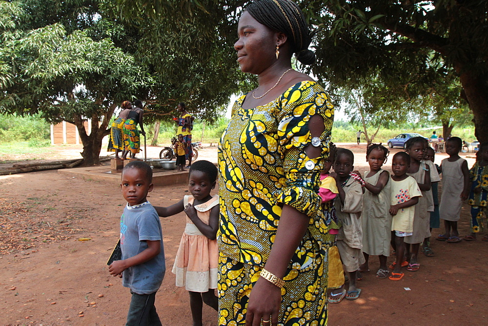 Teacher accompanying students to school, Hevie, Benin, West Africa, Africa