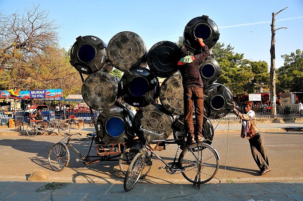 Men carrying water tanks on a bicycle rickshaw, Jaipur, Rajasthan, India, Asia