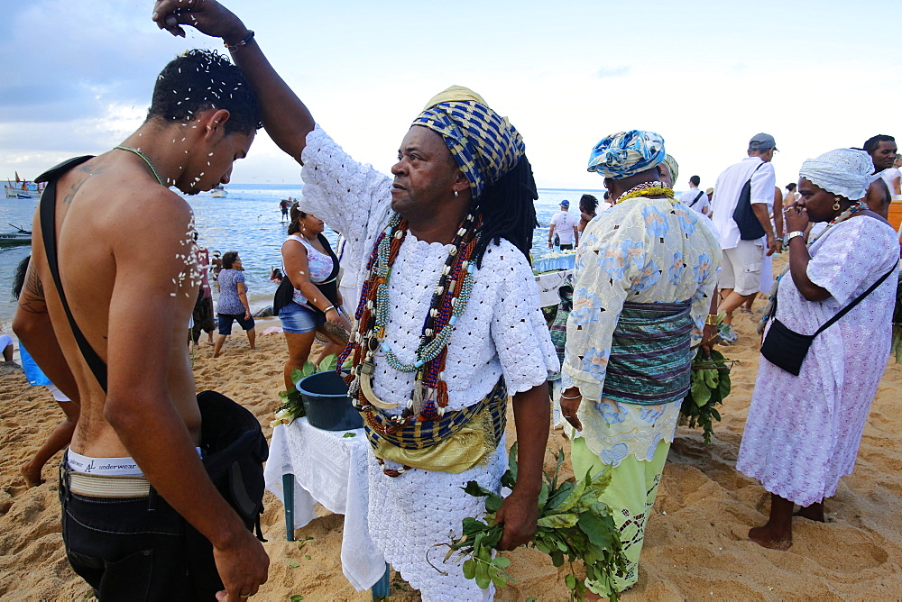 Candomble priest performing a ritual during Lemanja festival in Rio Vermelho, Salvador, Bahia, Brazil, South America - 809-5622
