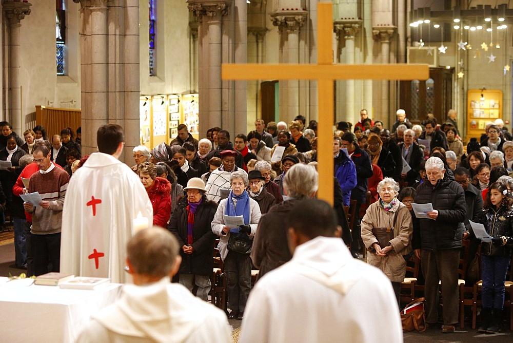 Mass in Saint-Hippolyte's church, Paris, France, Europe