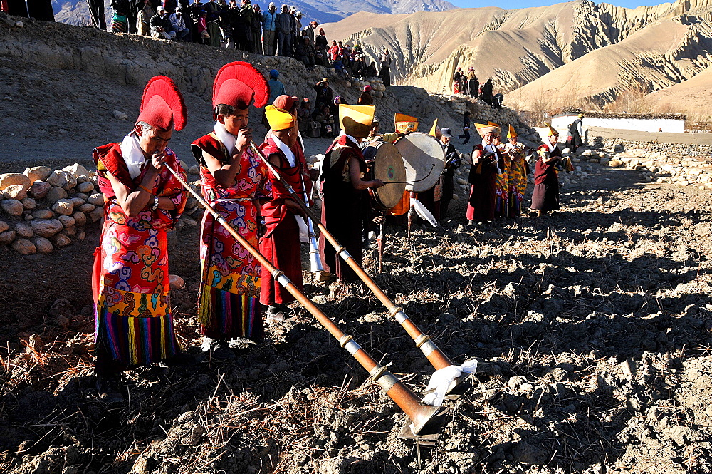 Ghami monastery monks blessing a field, Mustang, Nepal, Asia
