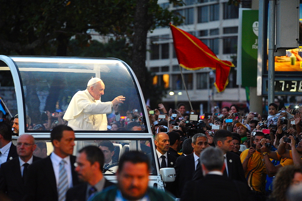 Pope Francis waves to the crowd while riding in the Popemobile, World Youth Day 2013, Rio de Janeiro, Brazil, South America