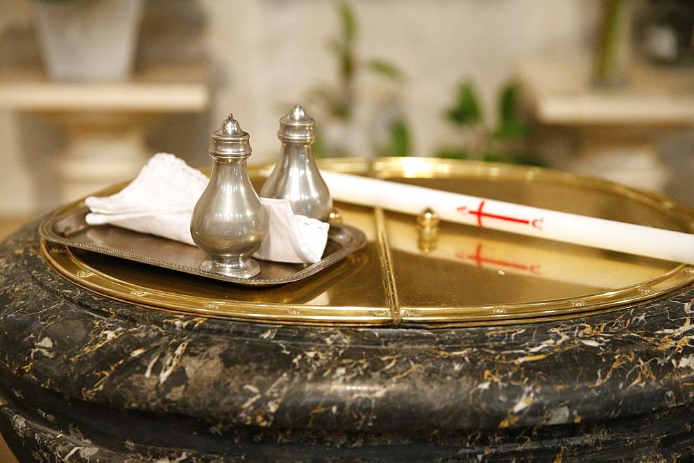 Baptistery, altar candle and chrism for the Baptism, Villemomble, Seine-Saint-Denis, France, Europe