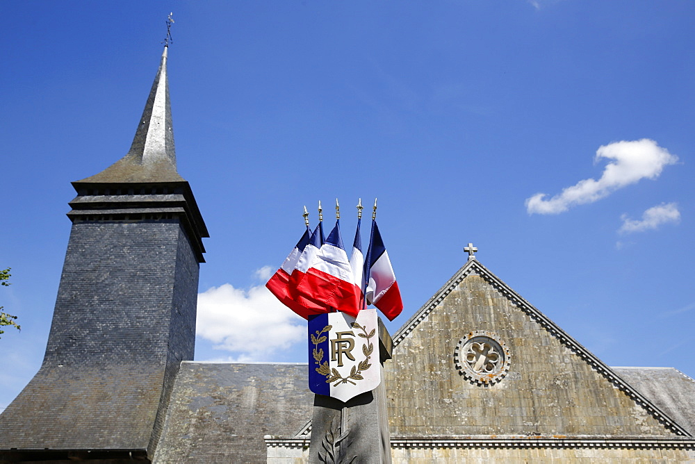 Church and French flags, Notre Dame du Hamel, Eure, France, Europe