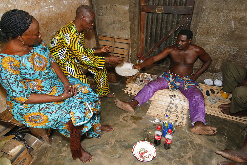 Couple visiting a fortune teller in Ouidah, Benin, West Africa, Africa