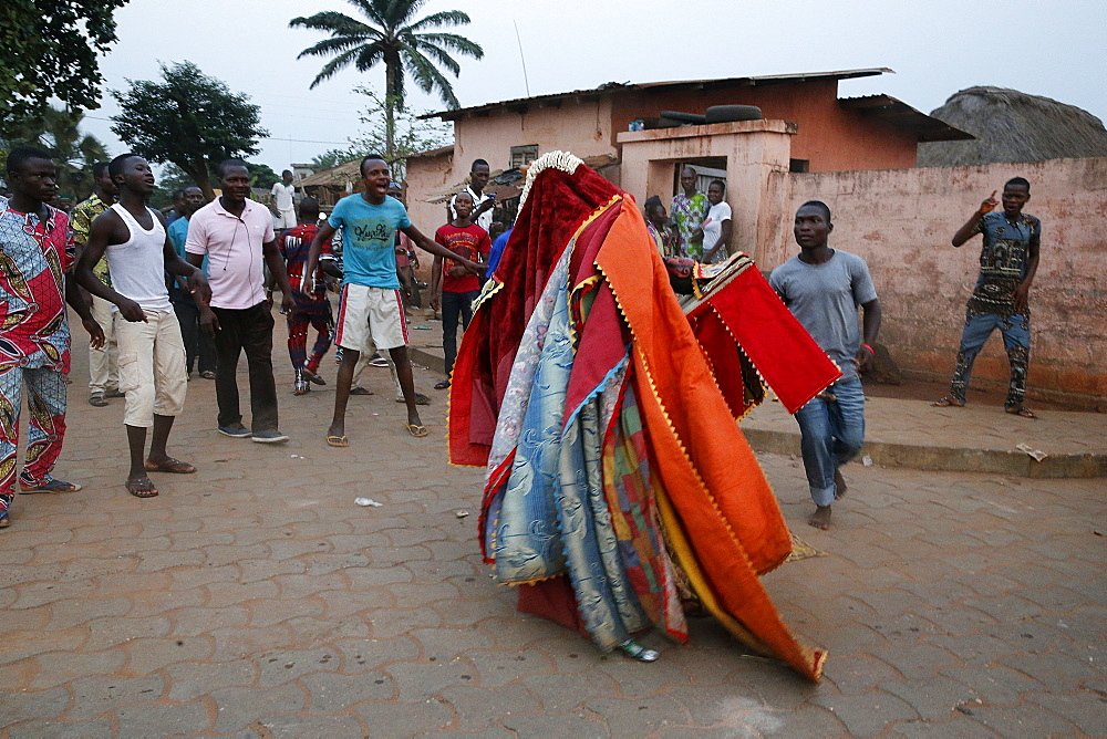 People keeping their distance as it's dangerous to touch the egoun-egoun, Feast of the Ghosts in Ouidah, Benin, West Africa, Africa