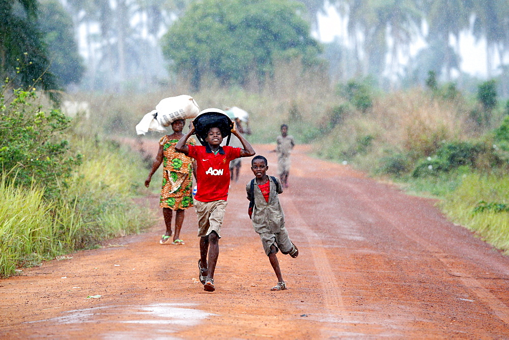 Children in the rain, Togoville, Togo, West Africa, Africa