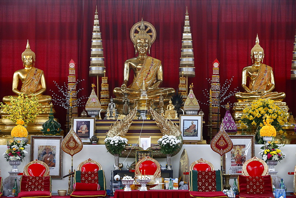 Buddha statues on main altar, Wat Velouvanaram, Bussy St. George, Seine et Marne, France, Europe