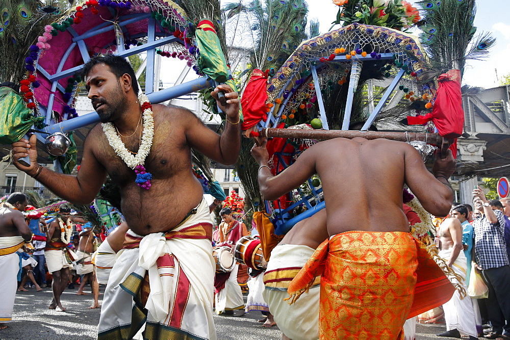 Men carrying kavadis and dancing, Ganesh Festival, Paris, France, Europe