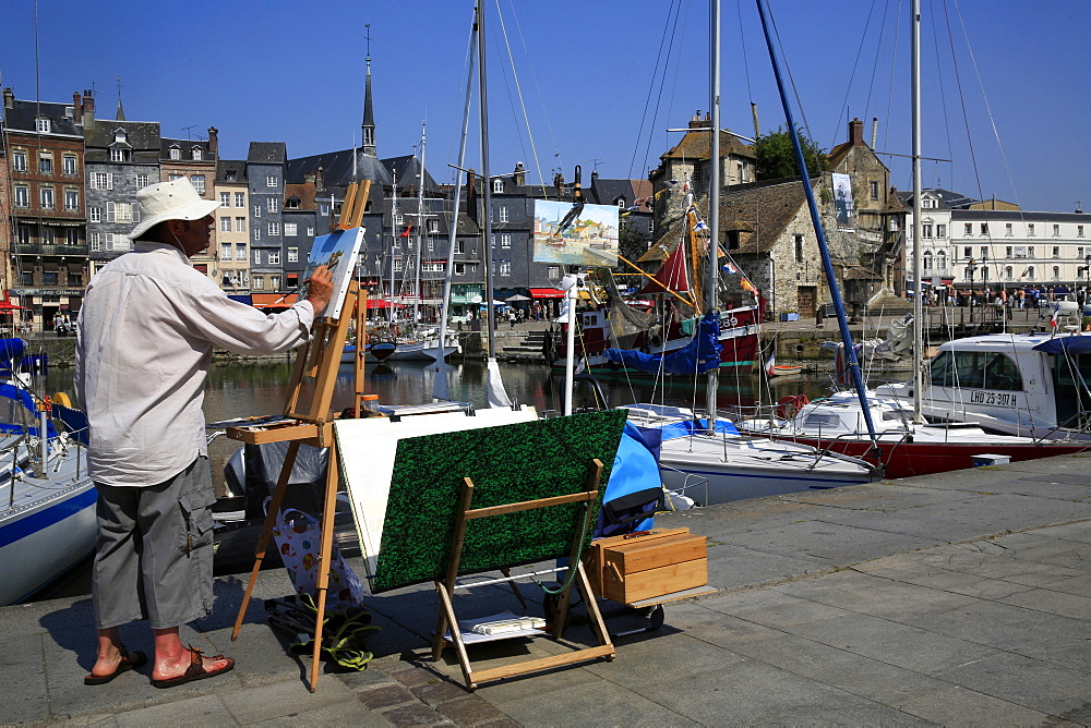 Painter on the quayside, Le Vieux Bassin, Honfleur, Basse Normandie, France, Europe
