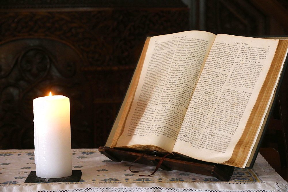 Old Bible and church candle, Carouge Protestant temple, Geneva, Switzerland, Europe