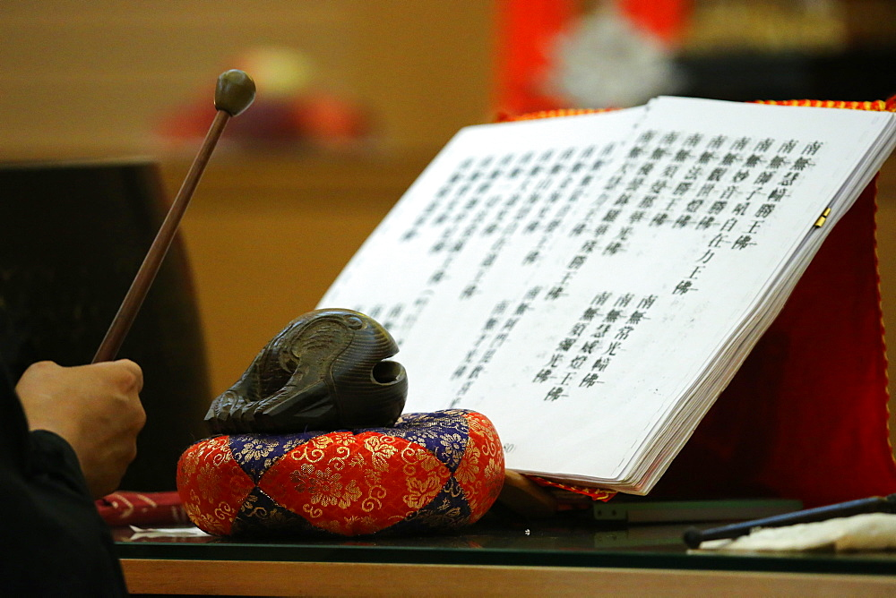Buddhist sacred texts and a wooden fish (percussion instrument), Fo Guang Shan Temple, Geneva, Switzerland, Europe