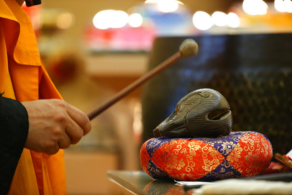 Monk playing on a wooden fish (percussion instrument), Fo Guang Shan Temple, Geneva, Switzerland, Europe