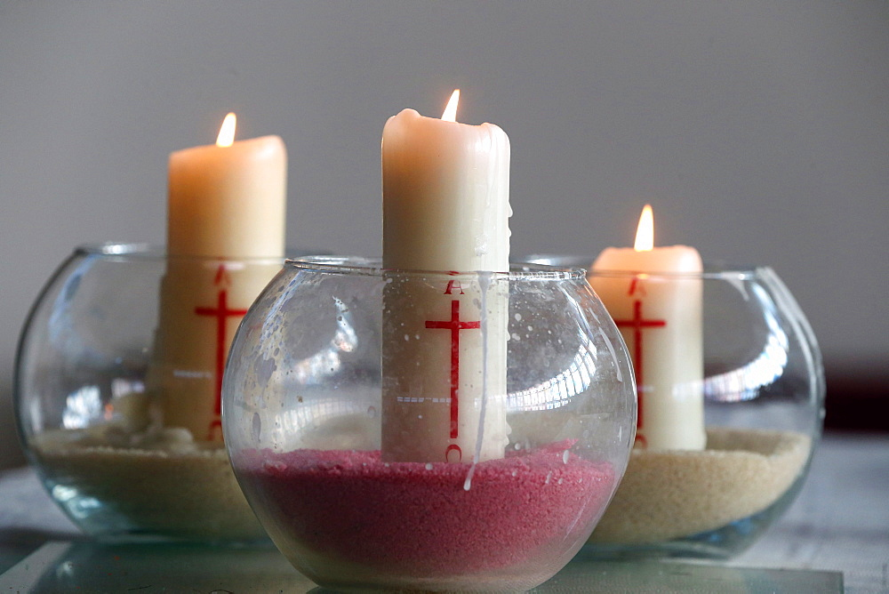 Three church candles in sand, Bussy-Saint-Georges, Seine-et-Marne, France, Europe