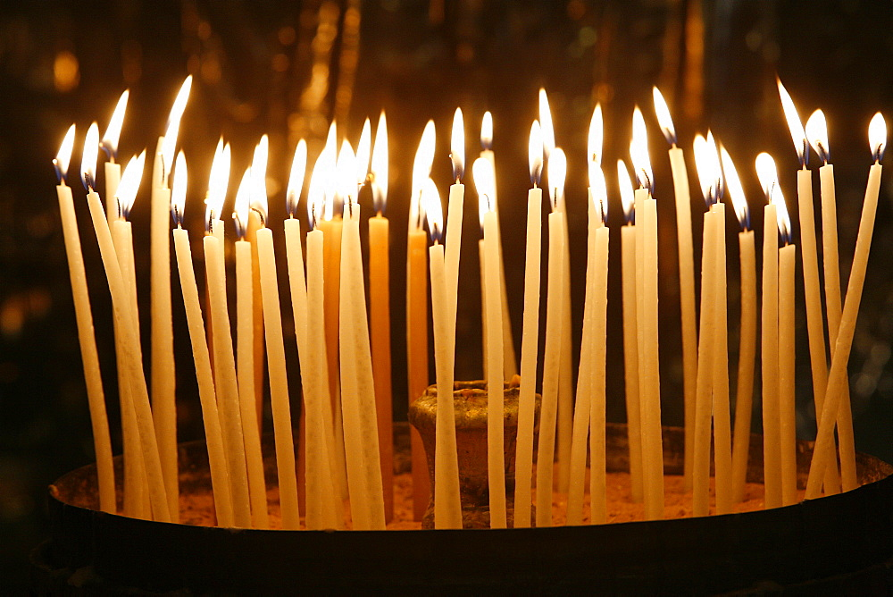 Candles in the Church of the Holy Sepulchre, Jerusalem, Israel, Middle East