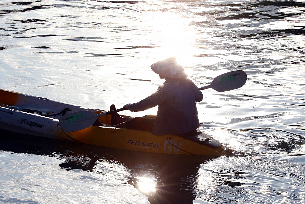 Man kayaking on the Nam Song River, Vang Vieng, Vientiane Province, Laos, Indochina, Southeast Asia, Asia