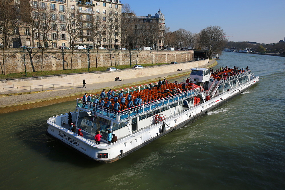 Tourist boat on the Seine river in Paris.