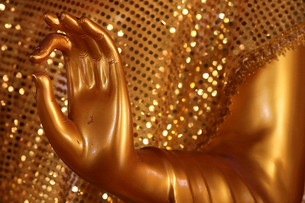 Close-up of a hand of golden Buddha statue, Wat Simuong (Wat Si Muang), Vientiane, Laos, Indochina, Southeast Asia, Asia