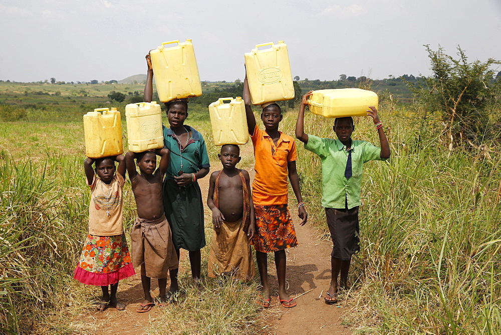 Ugandan children fetching water, Masindi, Uganda, Africa