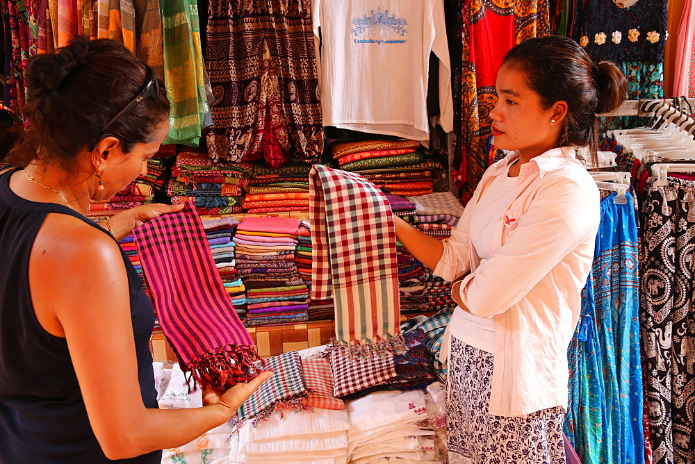 Woman buying scarves at Siem Reap market, Cambodia, Indochina, Southeast Asia, Asia