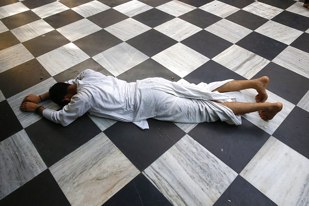 Hindu devotee prostrating at Krishna-Balaram temple, Vrindavan, Uttar Pradesh, India, Asia