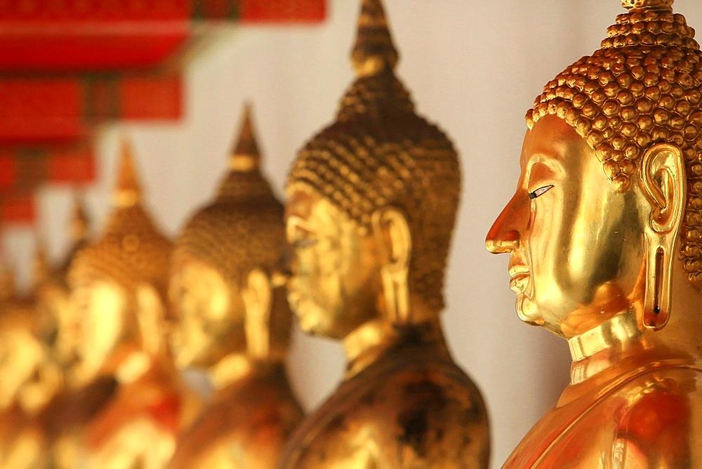 The meditation posture bronze Buddhas, Wat Pho, Bangkok, Thailand, Southeast Asia, Asia
