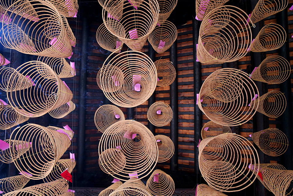 Sp[iral incense sticks in Taoist temple, Phuoc An Hoi Quan Pagoda, Ho Chi Minh City. Vietnam, Indochina, Southeast Asia, Asia