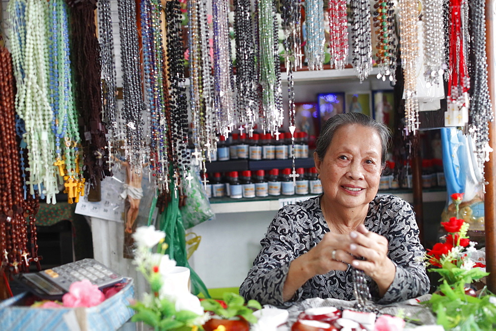 Shop selling religious christian items. Rosary prayer beads for sale. . Ho Chi Minh City. Vietnam.