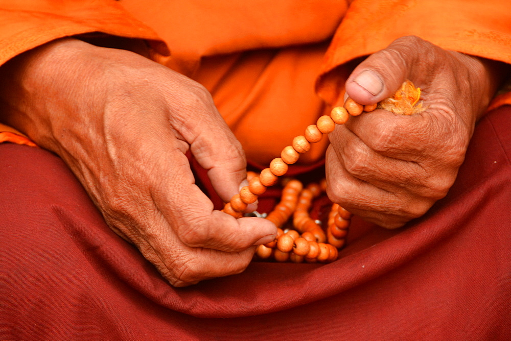 Tibetan monk holding prayer beads, Nepal, Asia