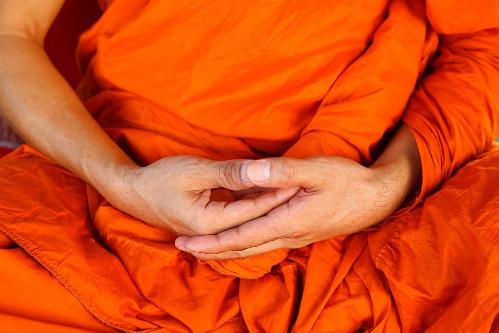 Monk meditating in Wat Trahimit, Bangkok. Thailand.